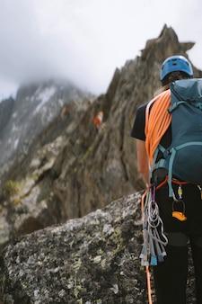 Backpacker climbing the frete du charmoz