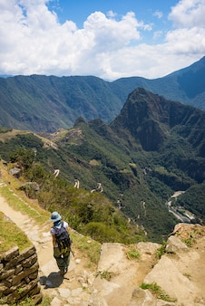 Backpacker on inca trail, exploration of machu picchu