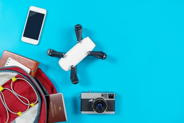Backpacker tourist travel gadgets and objects in backpack
