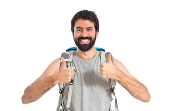 Backpacker with thumb up over white background