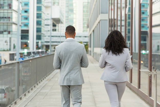 Backs of business colleagues wearing office suits