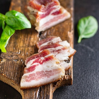 Bacon lard salted raw fat homemade pork meal snack on the table copy space food background rustic