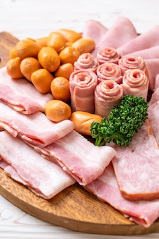 Bacon, sausages, smoked ham and barbecue bacon
