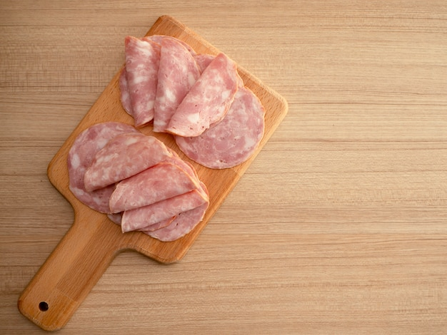Bacon sliced on a wooden background