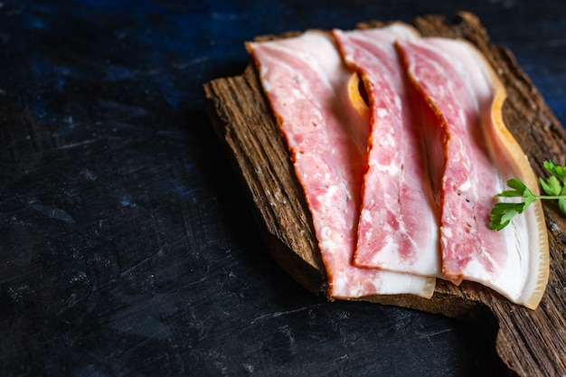 Bacon thin strip slice fatty meat and lard piece healthy food meal