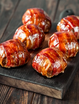 Bacon wrappped meatballs stuffed with cheese