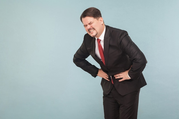 Bad feelings concept businessman have stomach pain