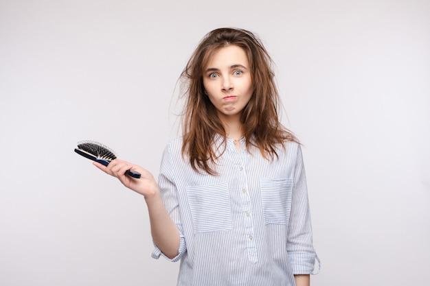 Bad hair day studio portrait.isolate on white.