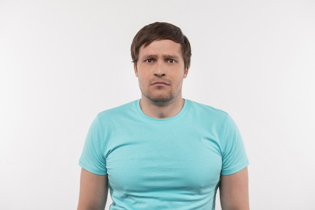 Bad mood. sad adult man looking at you while feeling upset