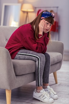 Bad mood. thoughtful girl bowing head while staring downwards
