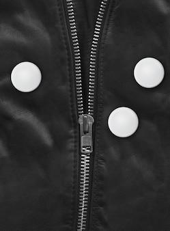 Badge on a black leather jacket close-up