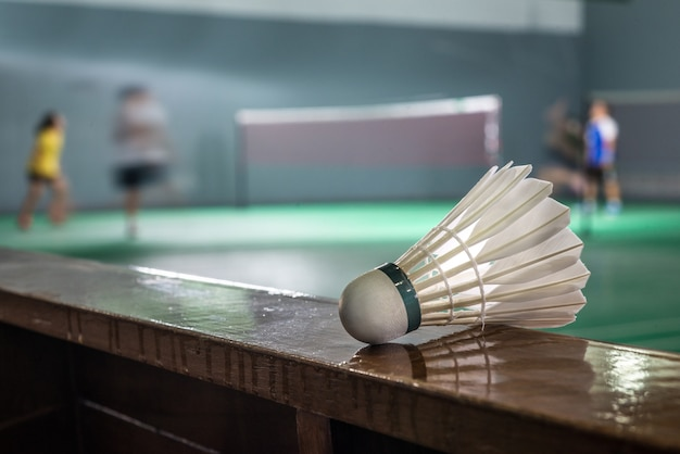 Badminton courts with players competing ,shallow depth of field