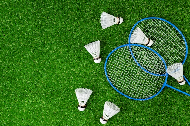 Badminton game rackets and shuttlecock on grass