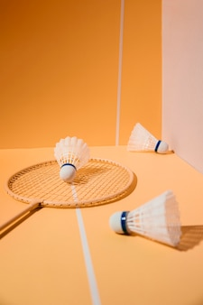 Badminton racket and shuttlecocks high angle