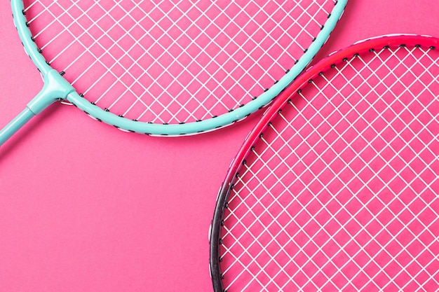 Badminton rackets on pink surface