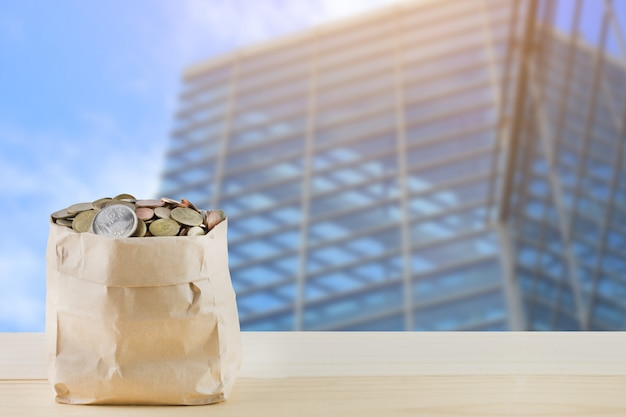 Bag of coins with building in urban.