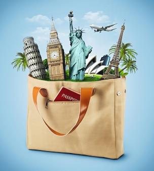 パスポート付きの有名なモニュメントがいっぱい入ったバッグ