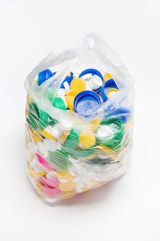 Bag full of plastic caps ready to be recycled. recycling concept. copy space