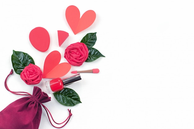 Bag gifts red roses green leaves cosmetics concept