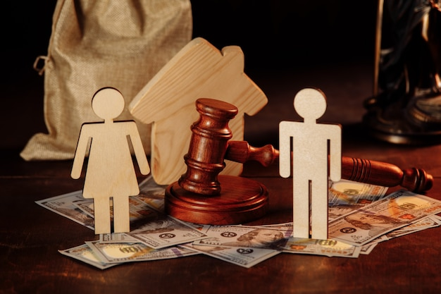 Bag of money people and the judges hammer divorce concept business conflict