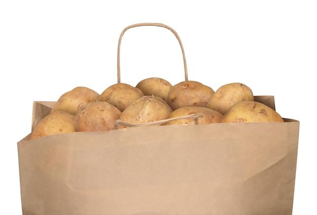 白で隔離されるジャガイモの袋
