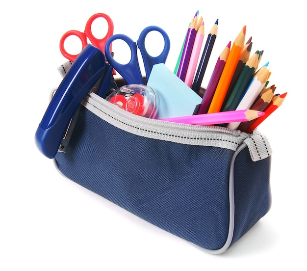 白い背景の上の学校の道具とバッグ