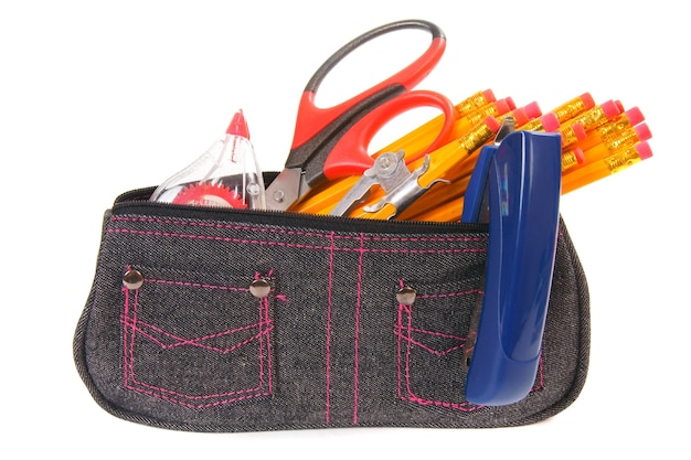 Bag with school tools on a white