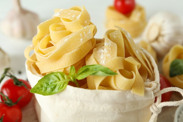 Bag with tasty uncooked pasta, close up