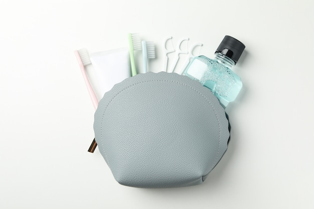 Bag with tools for dental care on white surface
