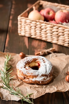 Bagel with basket of apples