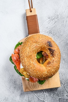 Bagel with salted salmon, cream cheese, avocado and egg.