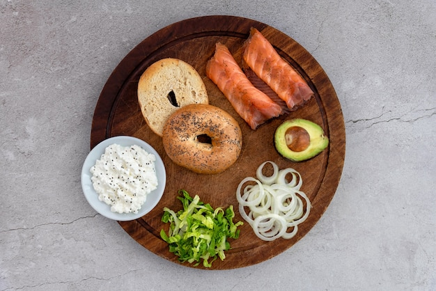 Bagels and ingredients for sandwich on table