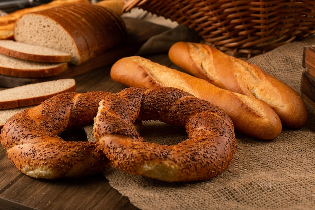 Bagels with baguette and slices of bread