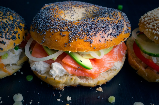 Bagels with cream cheese and smoked salmon on a black background