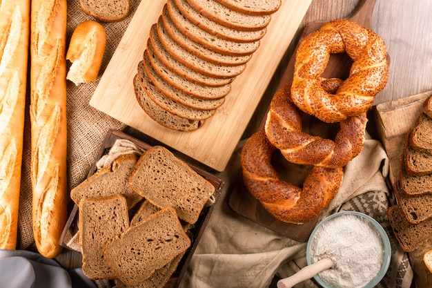 Bagels with french baguette and slices of bread