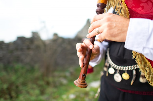 Bagpipe player detail. with traditional dress
