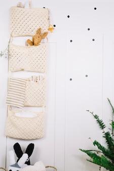 Bags with babystuffon nursery wall
