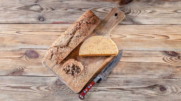 Baguette and cheese with spices and herbs. tasty and healthy bio food concept. top view