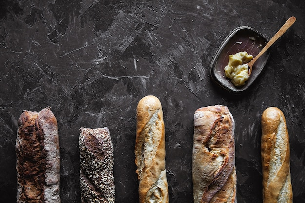 Baguette mix on a black background. french pastries, homemade.