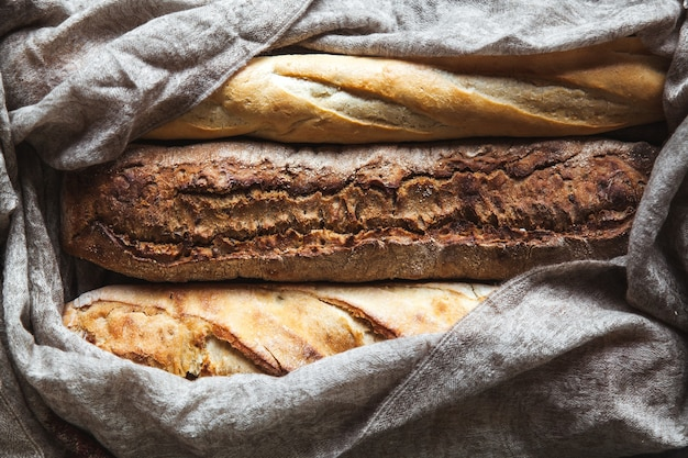 Baguette mix on a black wall. french pastries, homemade.