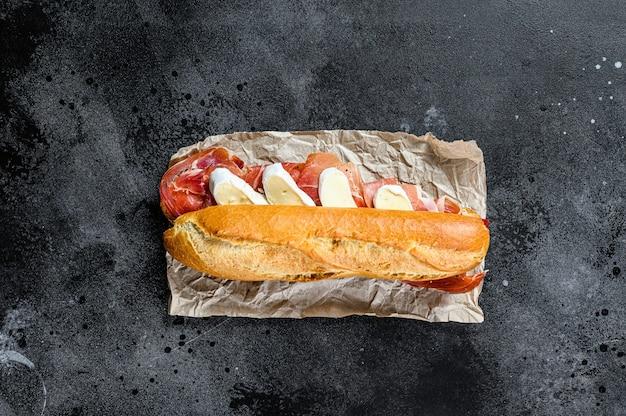 Baguette sandwich with jamon ham serrano, paleta iberica, camembert cheese