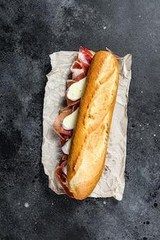 Baguette sandwich with prosciutto ham