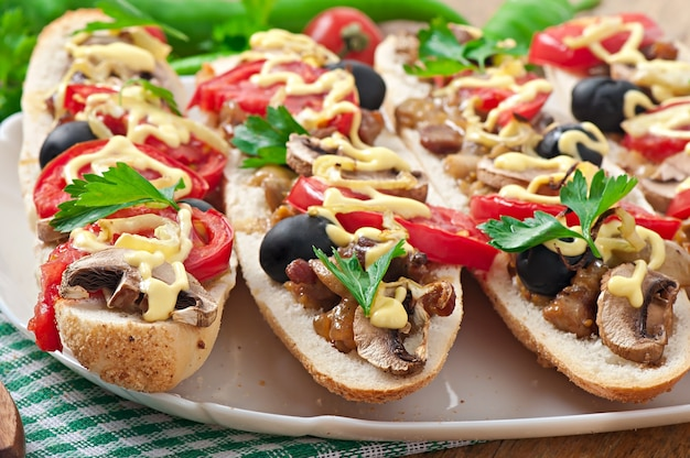 Baguette stuffed with veal and mushrooms with tomatoes and cheese