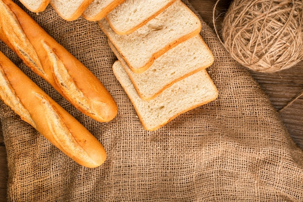 Baguette with slices of dark and white bread