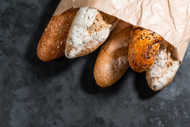 Baguettes in craft pack on a black surface