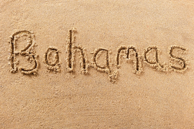 Bahamas beach writing message summer holiday concept