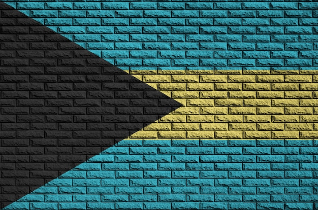 Bahamas flag is painted onto an old brick wall