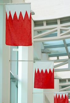 Bahrain national flags decorated in vertical position manama bahrain