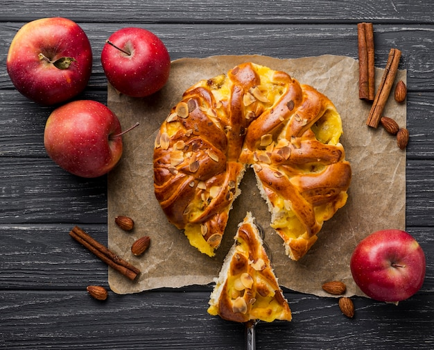 Baked apple pie and slice on cloth