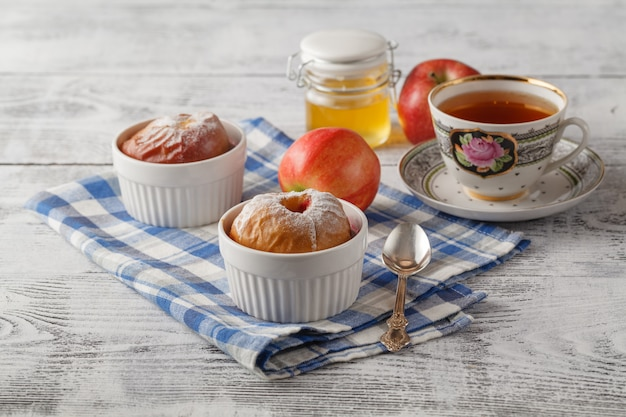 Baked apple with tea. puff pastry and cinnamon. with copy space